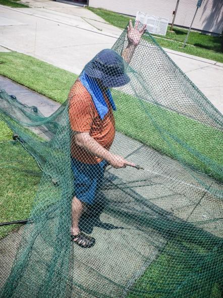 Rinsing the mud off a shrimp net